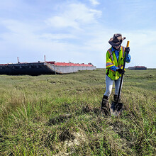 Survey with Beached Barges in Background